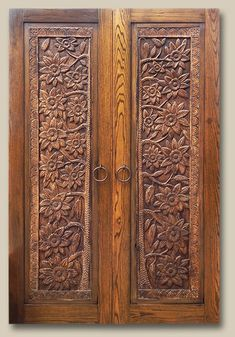 Double Doors Constructed with antique carved panels and reclaimed Douglas fir. Fitted with pull rings. 10094-01 Berning