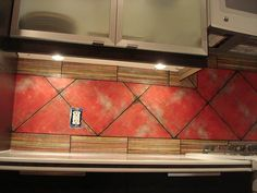 looks like tile - nope decoupaged wall with scrapbook paper - how cool is that..tk
