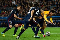 Lionel Messi of Barcelona is challenged by Lucas Hernandez of Atletico Madrid (19) during the UEFA Champions League quarter final first leg match between FC Barcelona and Club Atletico de Madrid at Camp Nou on April 5, 2016 in Barcelona
