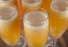 Peach bellinis are fruity, sweet and light. The perfect brunch cocktail for Mother's Day, Easter, wedding showers, New Year's and more.  Want a non-alcoholic version for a baby shower
