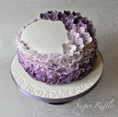 Purple Ombre Ruffles Cake         Light chocolate sponge layered with chocolate buttercream and rich dark chocolate ganache. Decorated wit...