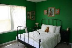 dark green bedroom with white accent