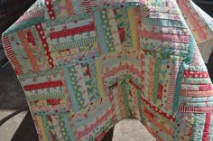 Love this strip quilt!  Easy pattern; great fabrics.