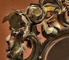 Rustic gilt gesso frame.