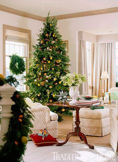 Instead of a strictly red-and-green holiday palette, the living room's scheme is one of nature's greens and winter whites, interspersed with touches of citrus yellow and lime. - Traditional Home ®/ Photo: Gordon Beall / Design: Joe Davis
