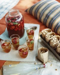 Strawberry-Basil Iced Tea  Strawberries and basil give nuance to iced tea. The drink is toted in an old-fashioned glass jar, with ice added just before serving. Small bags of pistachios are the perfect accompaniment - Martha Stewart Living, July 2009