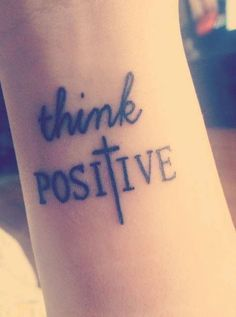 http://tattoomagz.com/cross-tattoo/cross-tattoo-think-positive/