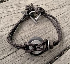 This men's brown leather bracelet looks very rustic. It's a creation of weathered upcycled washers, a nut and hammered nail for the clasp. NOTE - the washers, nuts, etc. are recycled and no two are al