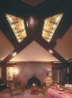 Frank Lloyd Wright's masterly hand shines in his 1902 Heurtley House in Oak Park, Illinois. In the living room, a dramatic stained-glass skylight complements a brick fireplace that is unadorned except for its massive, Sullivanesque arched opening. Photo: Paul Rocheleau