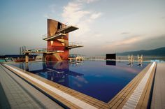 This angular new diving tower built in 2012 for the Rijeka Olympic centre has 5 diving boards placed at different heights designed according to FINA rules. The architectural approach taken by studio zoppini associati was to create a cutting-edge High Diving, Scuba Diving, Diving Board, Visit Croatia, Tower Building, Pool Accessories, Pool Supplies, Green Landscape, Beautiful Sunrise