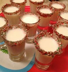 Candy Cane Shots!  What You Need:  Godiva White Chocolate Liqueur Peppermint Schnapps Crushed Candy Canes  How To Make:  - Wet the rim of a shot glass and dip into the crushed candy canes.  - Mix equal parts Godiva white chocolate liqueur and Peppermint schnapps together, shake and pour into the rimmed shot glass.  - Enjoy!  *Different kinds of alcoholic and/or non alcoholic beverages can be used.