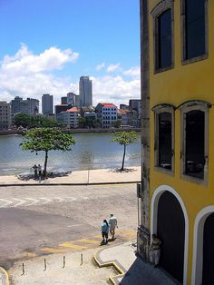 Recife, Brazil. A mix of contemporary and colonial. Lots of colors. Great people and sea food!