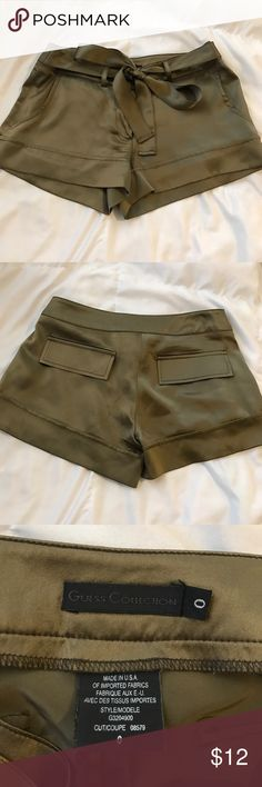 Guess Silk Shorts Size 0 100% silk Guess shorts. Really pretty olive color, they just don't fit me. No flaws, excellent condition Guess Shorts