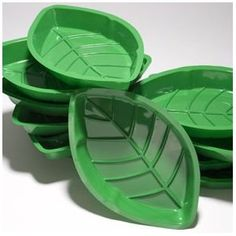 "Palm Leaf Serving Trays $9.08 on Amazon A dozen dishes per package. 12"" long, 7 1/4"" wide and 1 1/2"" deep. Made of plastic. These would be perfect to set out food on the table!"