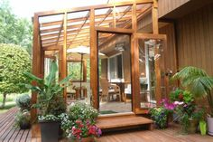 "Lean To Greenhouse | Beautiful 10' x 20' with 18"" & 30""cedar basewalls & glass to ground."