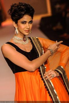 A model walks the ramp for jewellery brand Charu Jewels during the India International Jewellery Week (IIJW), held at Grand Hyatt, Mumbai, on August 06, 2013.