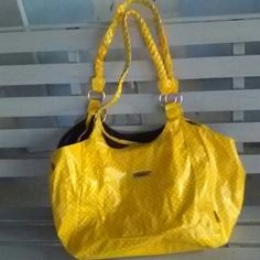 """Purse Spring is here! Mudd bag bright soft patten yellow with white poka dots. Excellent. Condition inside and outside. Purse 18"""" wide 10"""" deep. From straps hangs 21"""" long. Mudd Bags Hobos"""