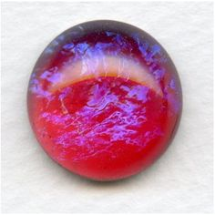 GLASS cabochon: called Dragon's Breath, or Mexican Opal (because of the blue flashes) NOT an actual OPAL, but beautiful nonetheless