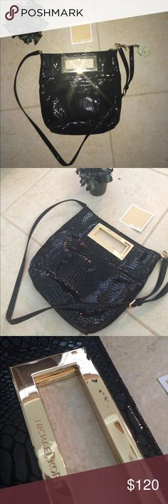 Michael kors handbag (authentic) Great condition snakeskin print black and Gold handbag / clutch ! Does come with strap which is a great feature and does come with small card that they come with when you buy they. Also comes with removable Michael kors keychain as seen in picture. Am accepting offers but remember I do have they keychain and strap with it :) happy pushing my friends ! Michael Kors Bags Crossbody Bags