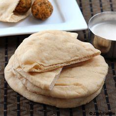 Pita Bread 1.5 cups whole wheat flour 1.5 cups all purpose flour 1 tbsp sugar 1 tsp salt 2 tsp instant yeast 2 tbsp olive oil 1.25 cups water