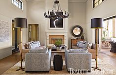 A stunning photograph by Hiroshi Sugimoto is the focal point of the living room, which features facing sofas from Hollywood at Home and floor lamps from Lucca Antiques. The pair of swivel club chairs from Cisco Home are upholstered in an Idarica Gazzoni flower fabric. The Mitakostool by Christian Astuguevieille is made of painted rope.