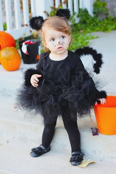 """You're in luck–€""""this adorable costume is a breeze to make. With a little help from wire, a hot glue gun, felt, and thread, you can transform a black feather boa into a cat tail and ears for your furry feline."""