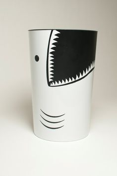 Great White Garbage Can!  Just take a white garbage can draw the eye, gills at bottom, mouth and teeth and fill in with black paint. Easy!!