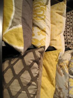 pillows in gold, brown, & gray