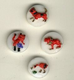 4 glass buttons dog cat circus lion duck..vintage kiddie buttons. White opaque…