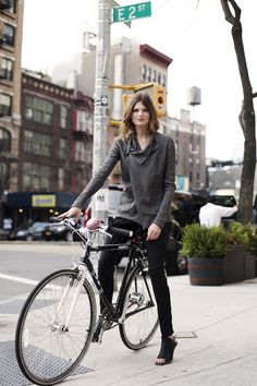i love the drape of the collar and the slant of the placket. and the fact that she's riding a bike with heels on. not realistic--but beautiful.