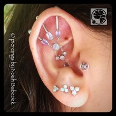 Four point #industrialpiercing and #tragus piercing with #whitegold #tanzanite and #opal #jewelry by #bvla (at Evolution Piercing)
