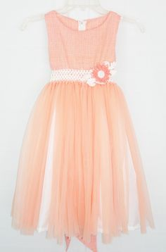 Peach flower girl dress. Like the fabric & mix of peach and white at the bottom