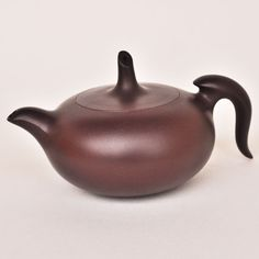 Yixing teapot. Reminds me of a beautiful deep chestnut with a black mane and tail.