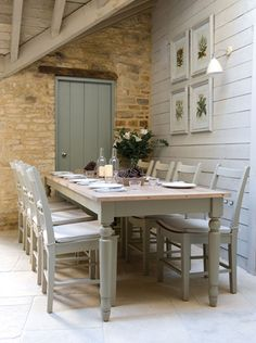 Table and chairs. NB horizontal boarding on wall