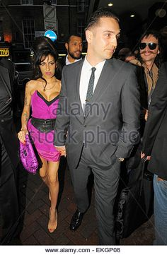 13.JULY.2010 - LONDON  AMY WINEHOUSE AND BOYFRIEND REG TRAVISS ARRIVING AT THE…