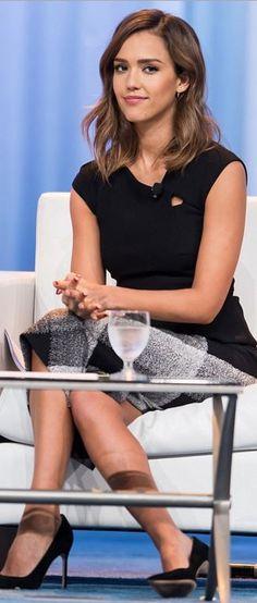 Who made  Jessica Alba's gray print skirt and black top?