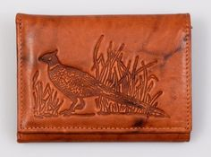 Pheasant Embossed All Leather Trifold Wallet by Rico. $24.99