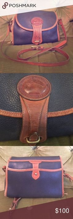Vintage Dooney and Bourkr purse Vintage, used, all weather leather! Navy and brown with long adjustable strap! AUTHENTIC Dooney & Bourke Bags Shoulder Bags