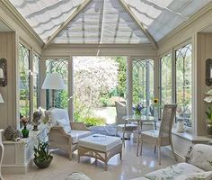 This lovely conservatory has double doors to the garden and Gothic arched window design. Styled internally with furniture and accessories from Interiors by Vale.