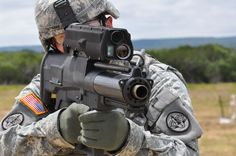 U.S. Army soldier firing an XM25 air burst grenade launcher also known as 'The Punisher'[4288  2848]