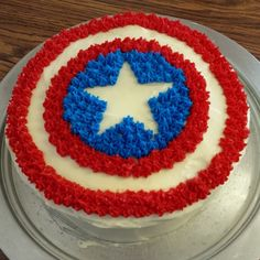 Captain America cake. I decorated this birthday cake for my son's 9th birthday. It was a big hit! I used a template to help with the outline of the star (template can be found here: http://www.pinterest.com/pin/189854940517165763/). This is the first time I have ever decorated a cake while also having an IV line in! It was tricky to do it with an IV, but the easy pattern was still doable. #chronicillnessmom