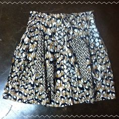 NWT Anthropology Parameter Skirt This absolutely gorgeous Anthropologie skirt is brand new, never been worn, and is in perfect condition! It is perfect for any season and has a beautiful mustard yellow, deep purple, dark blue, and cream pattern! It has bronze buttons/snaps down the front and pockets as well! Would look amazing with a pair of tights and a cardigan! Make an offer! Anthropologie Skirts