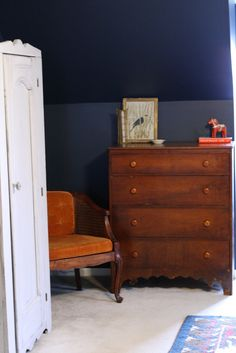 Primitive & Proper: My New Bedroom Dresser & The Start of a Gallery Wall; navy and rustic wood