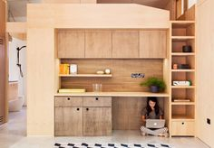 Lovely and simple interior with timber cabinetry. Like the use of recessed upper cupboards. Australia's first carbon-positive prefab house produces more e...