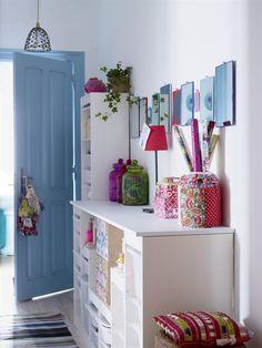 Hallway storage units and colourful decor