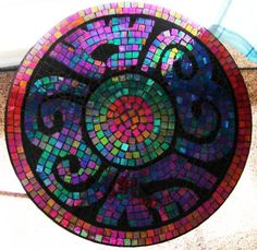 Mosaic tile tabletop This is a great idea for updating a glass top patio table!