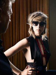 On the set of the Burberry 2016 campaign. Edie Campbell wears a cut-out and panelled silk dress with modern, classic sunglasses.