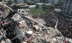 Rescuers in 2013 gather at the collapsed eight-storey Rana Plaza garment building, near Dhaka, Bangladesh.