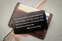 This wallet insert (metal wallet card) will be engraved with your own text. Perfect for a wedding day, anniversary, deployment, or that special someone. {SPECS} • Ultra thin metal, strong but will not bulk up the wallet • Laser engraving will not fade or wear off • 300 characters per side including spaces is recommended for best fit and looks • Color options: black, red, blue, purple, orange, pink, gold, silver, green  {ORDERING} • Give engraving instructions in the Notes section in your…