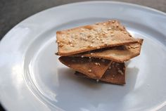 Homemade whole wheat cracker recipe... pretty much just flour, salt and water with a sprinkling of sesame seeds. How easy is that?